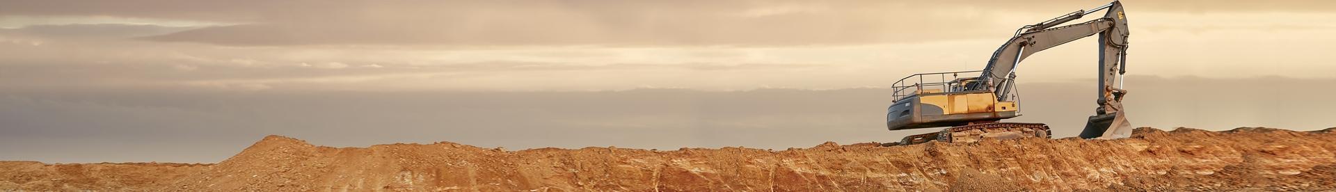 Koparka na wzgórzach Banner